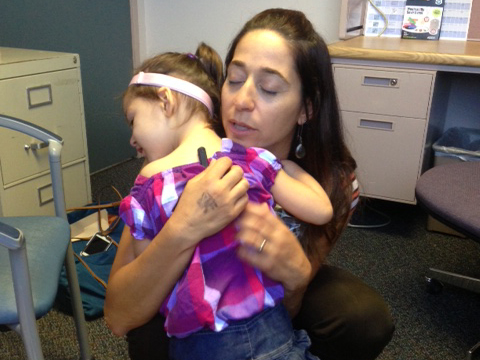 HearAid Foundation recipient gets fitted for her new hearing aids, seen here hugging HAF executive director Tanya Penn